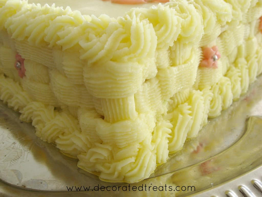 Buttercream basket weave piping on the side of a cake