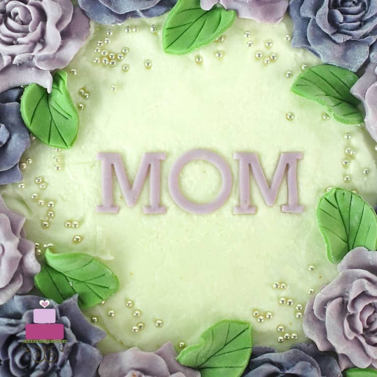 Alphabets MOM on a cake in purple