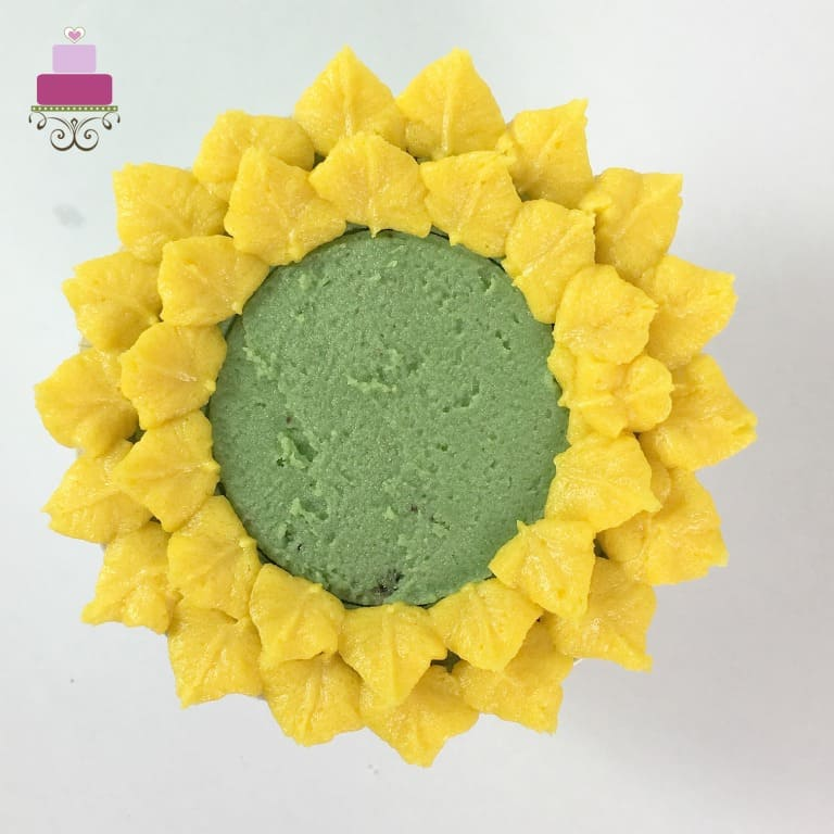 A green cupcake with 2 layers of yellow petals
