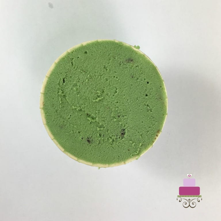 A green icing covered cupcake