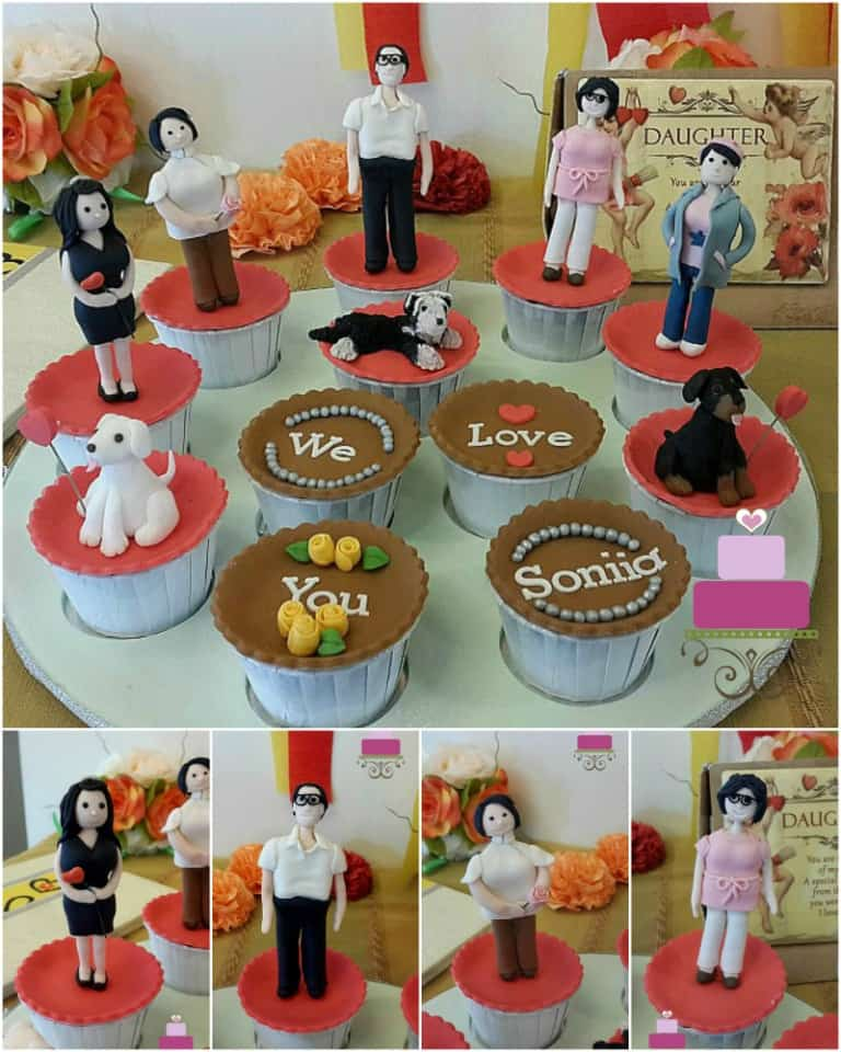 A set of cupcakes decorated with human figurine and dog toppers