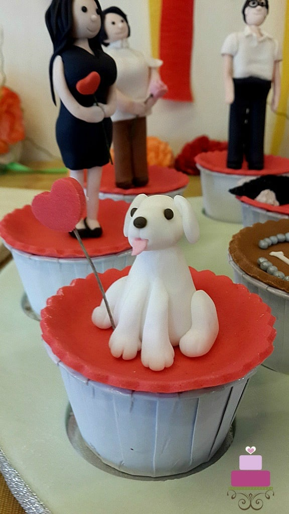 A cupcake with a white dog topper