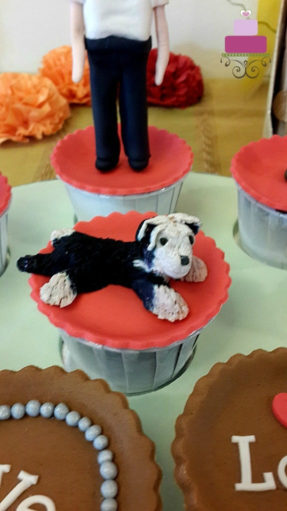 A cupcake with a black and white dog topper
