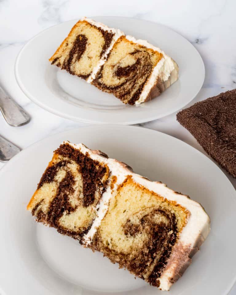 2 slices of marble cake on white plates