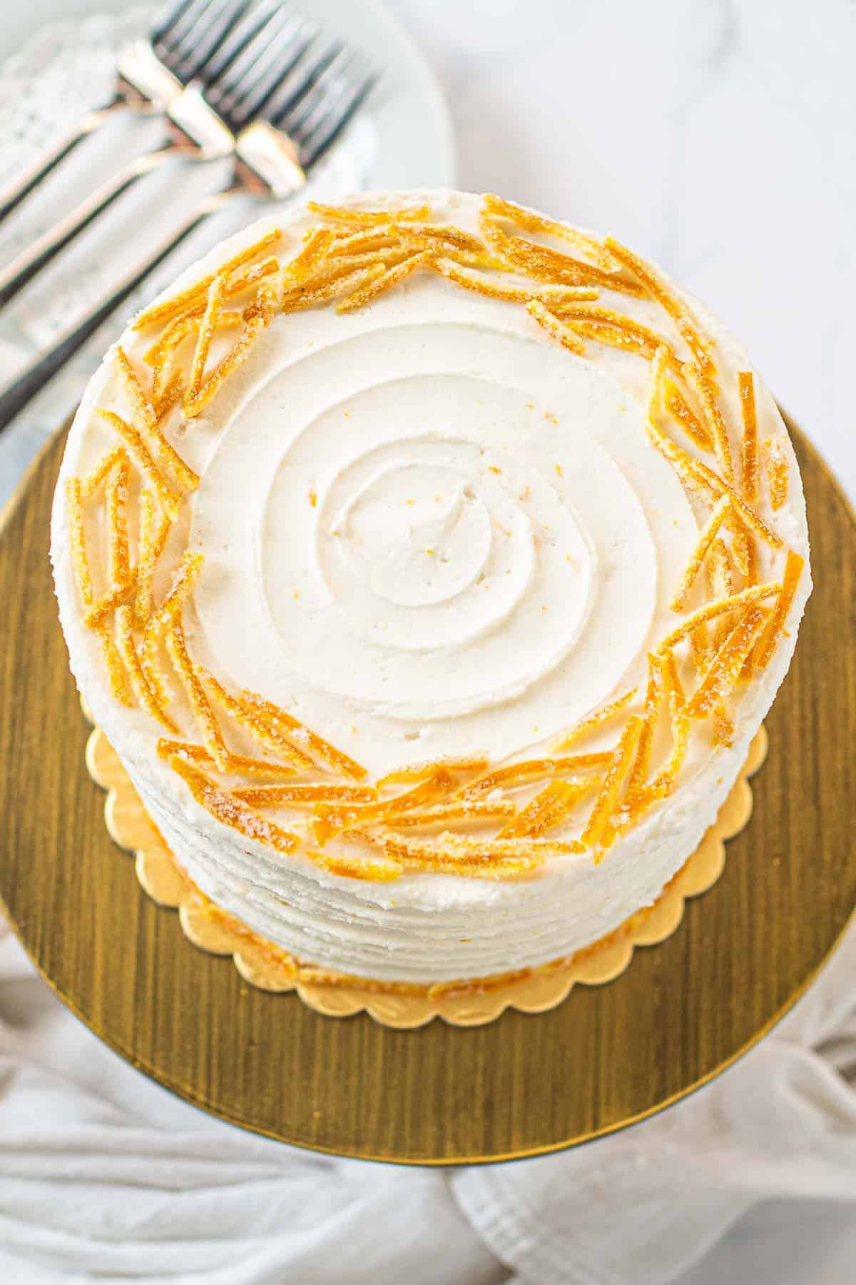 Top of a round cake decorated with candied orange peels