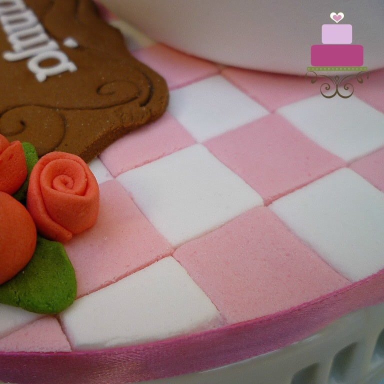 Pink and white checkered cake board