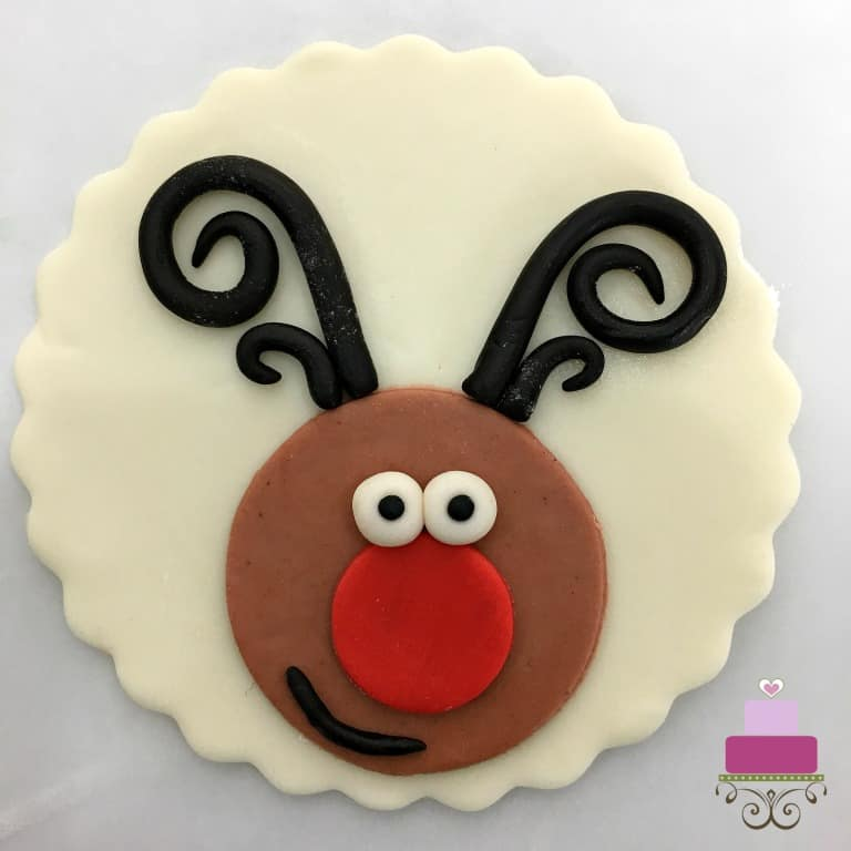 Cupcake topper with reindeer face