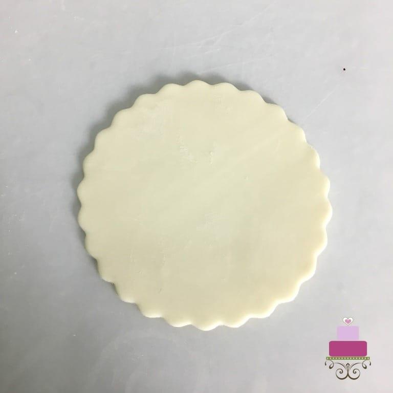 A round piece of white fondant