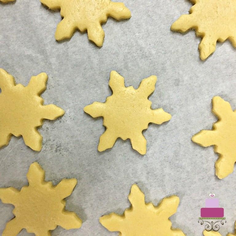 Unbaked snowflakes shaped sugar cookies