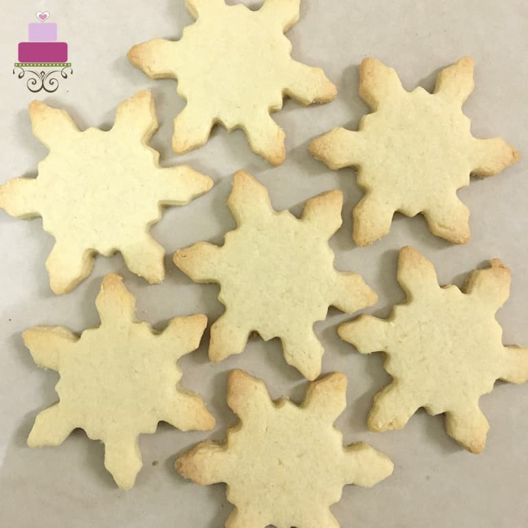 baked snowflakes shaped sugar cookies