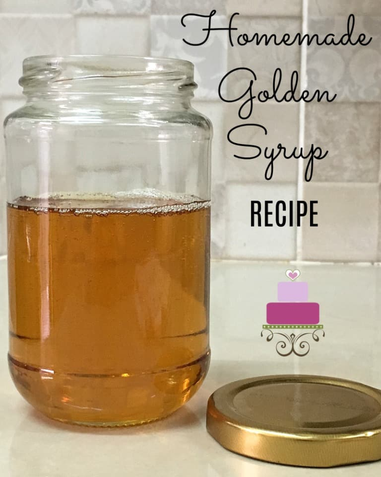 A jar of homemade golden syrup with the lid open