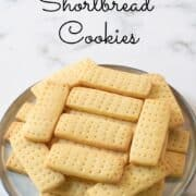 A plate of rectangle shaped shortbread cookies