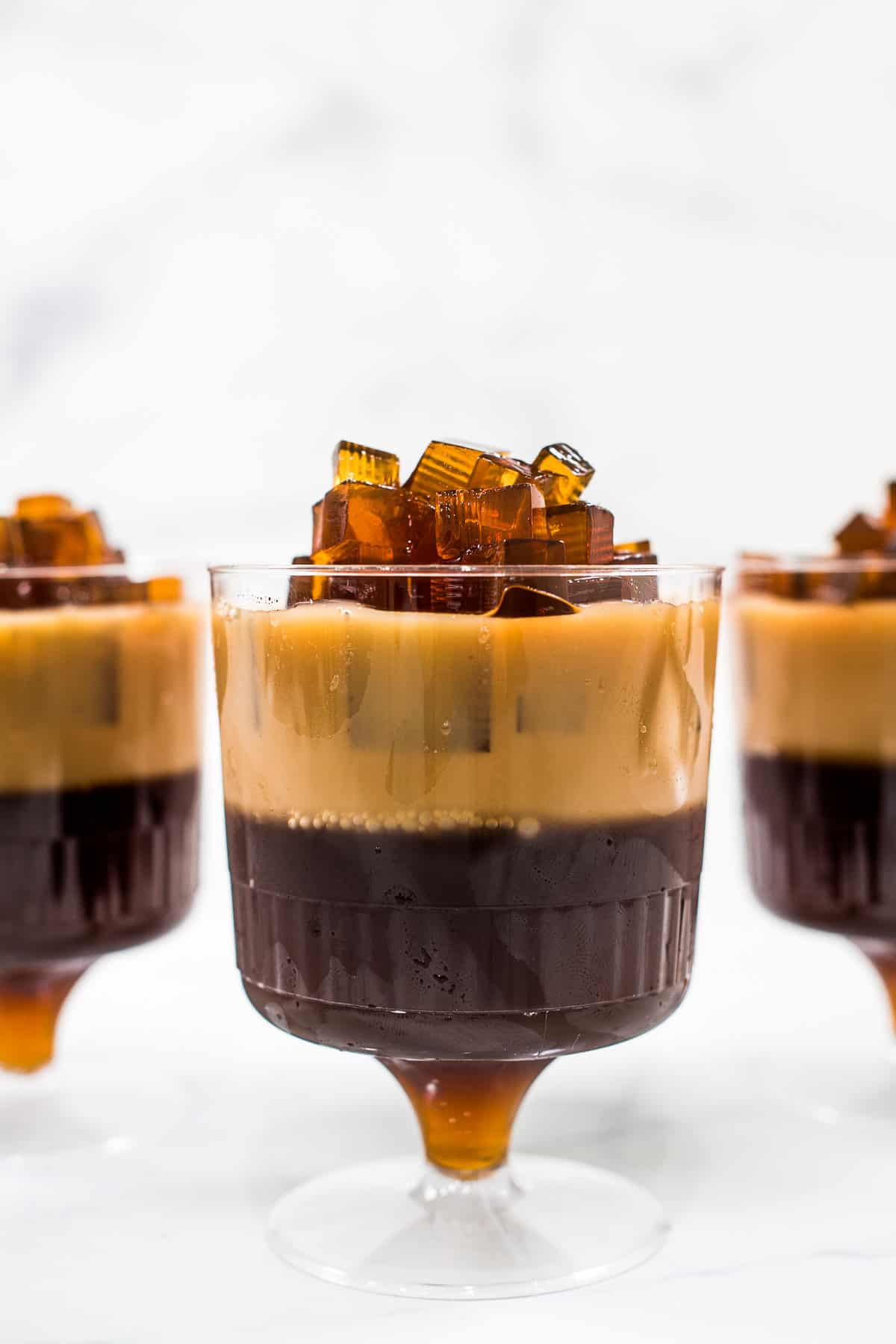Mini cups with 2 layers of coffee jelly in a mini cup topped with black coffee jelly cubes