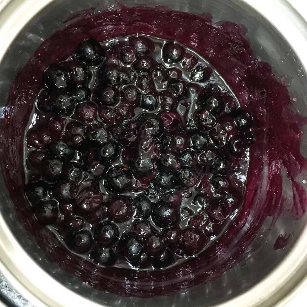 A small pot of blueberry filling