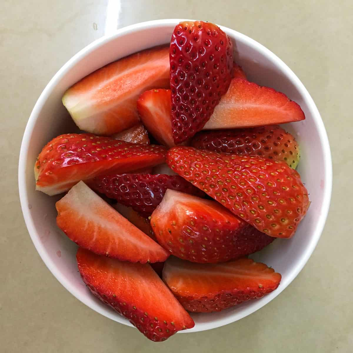 A bowl of cut strawberries