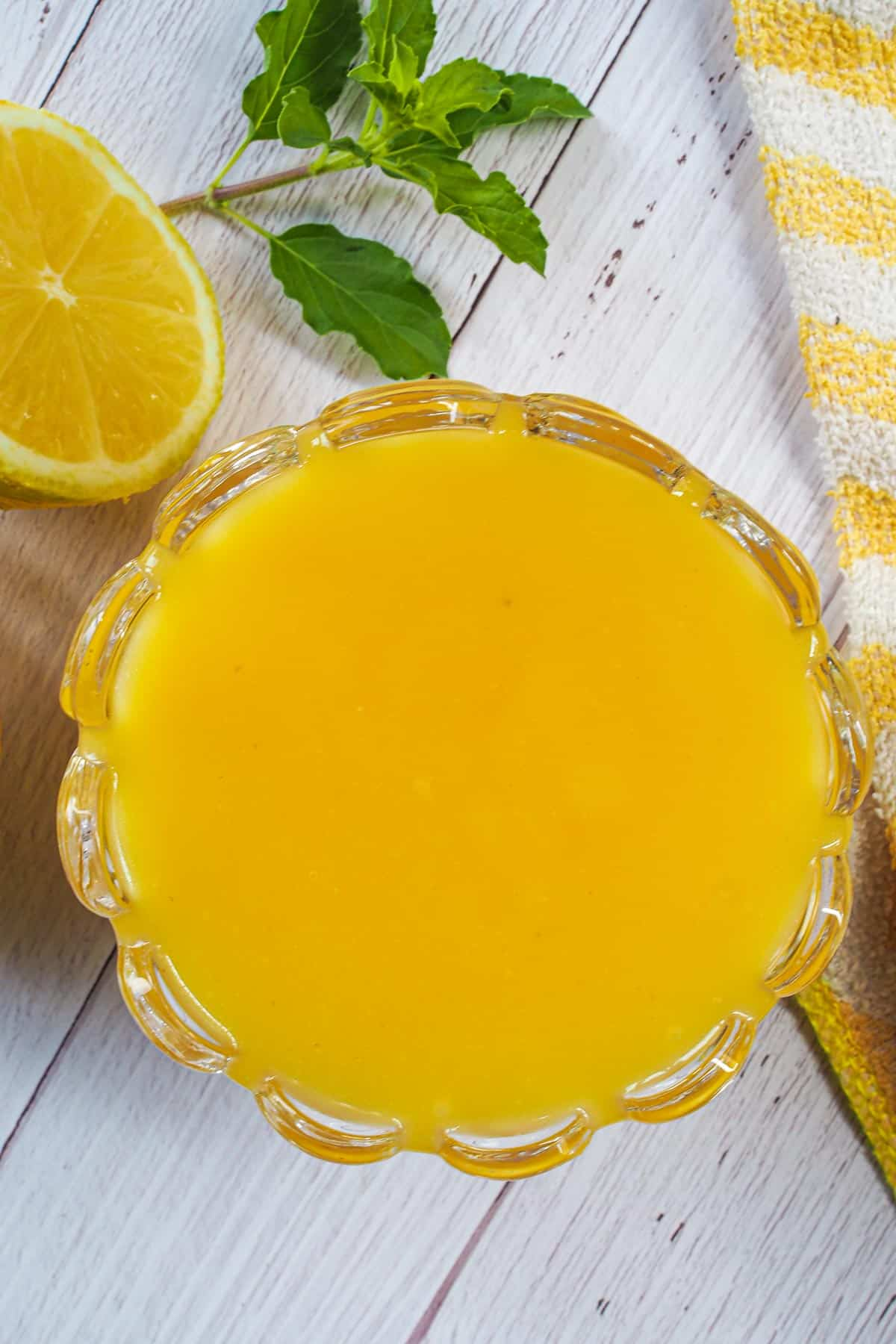 Top view of a glass jar of lemon curd