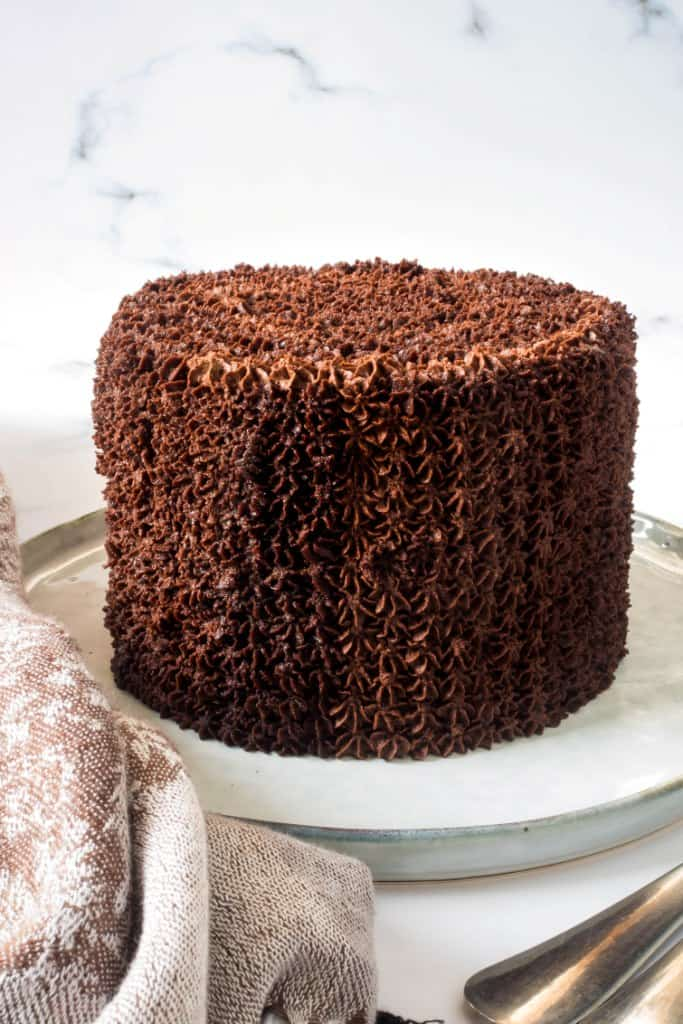 A round chocolate cake covered in chocolate icing