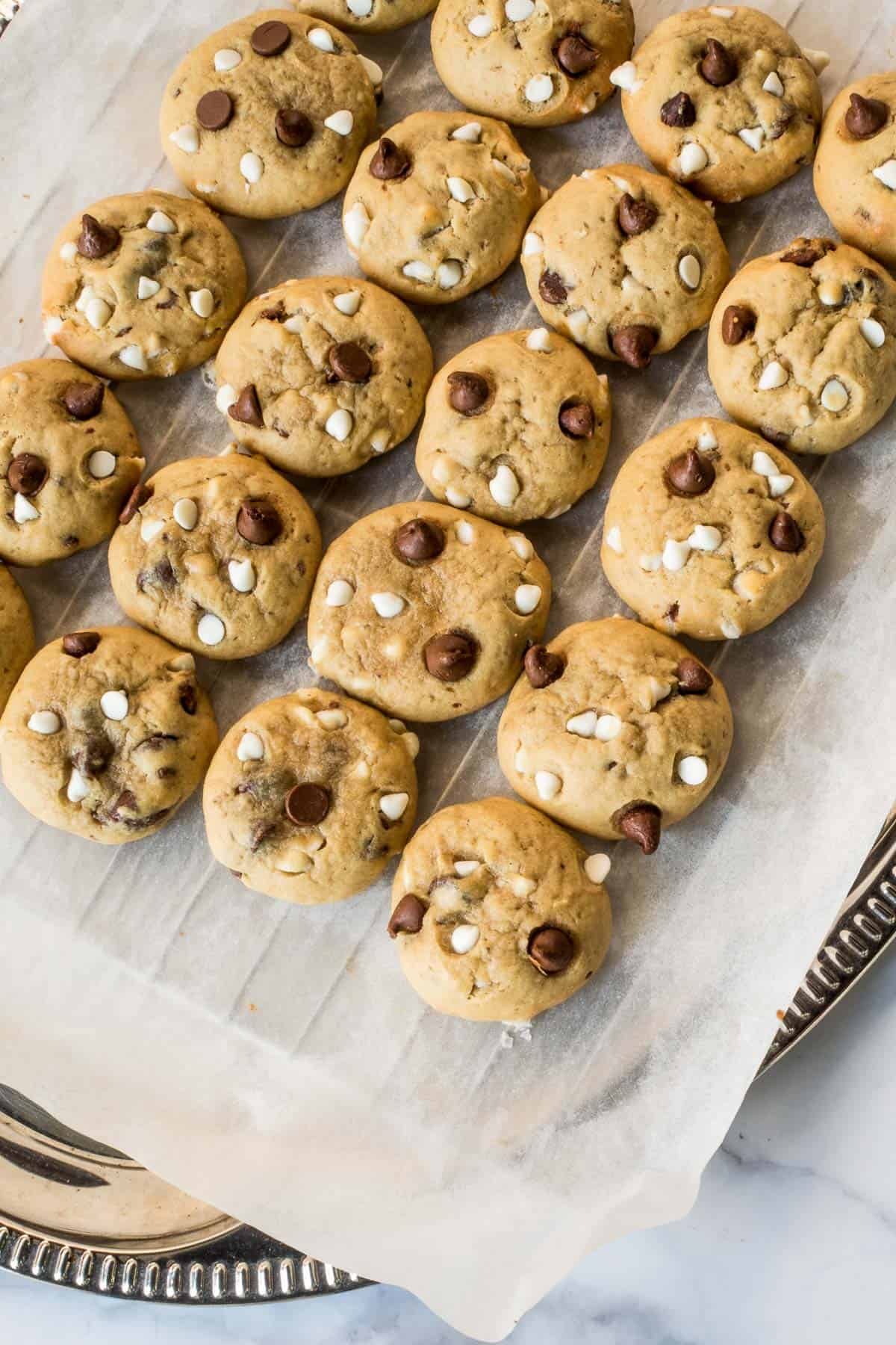 Chocolate chip cookies on a parchment lined wire rack
