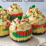 Mini marbled cupcakes topped with whipped cream and Christmas sprinkles