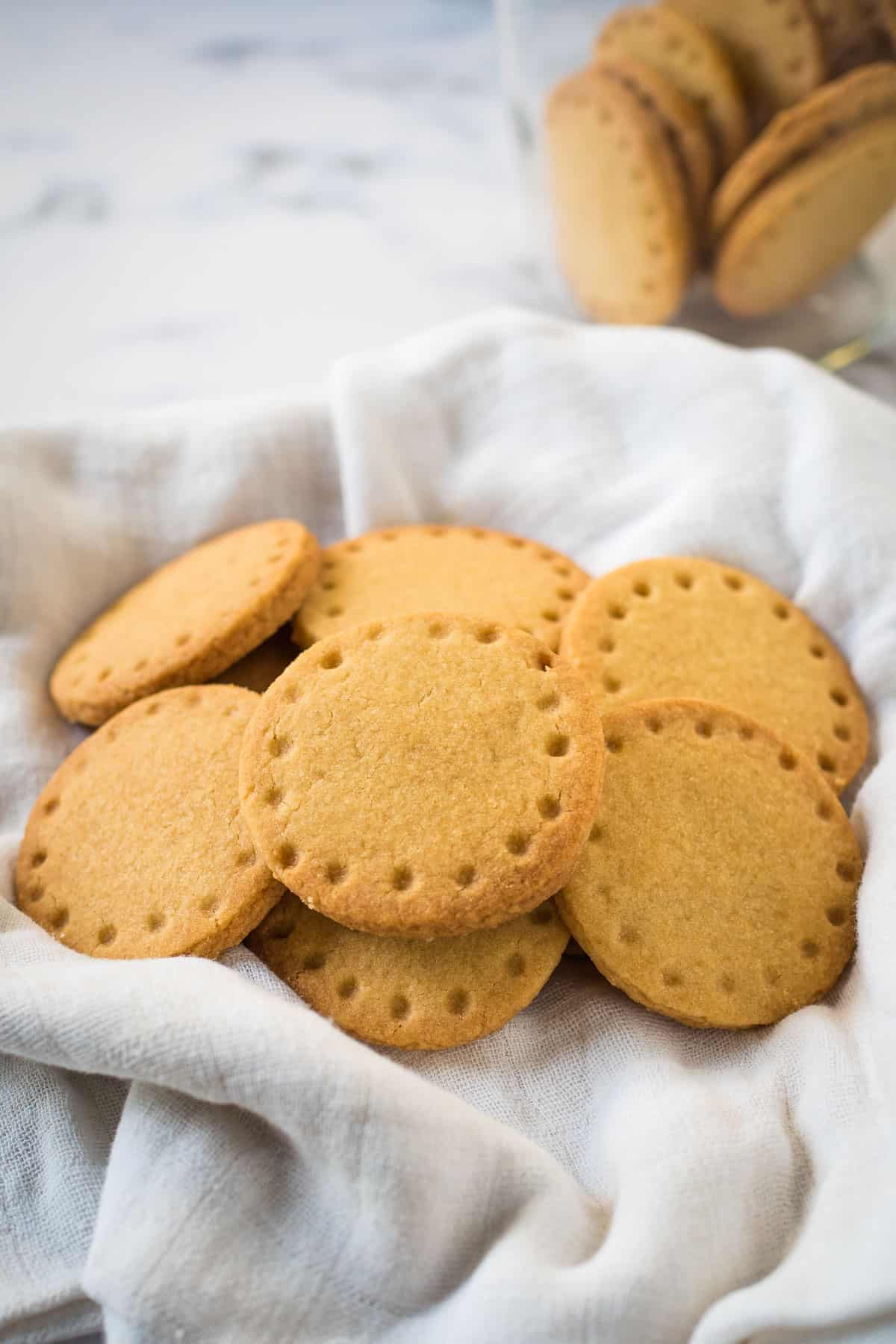 Round cookies on a cloth lined basket