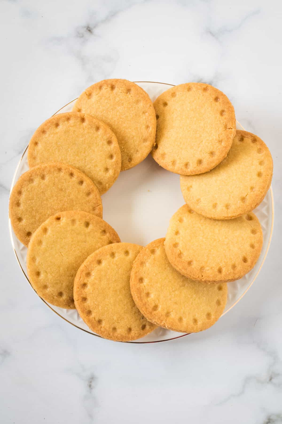 A circle of round cookies on a white plate