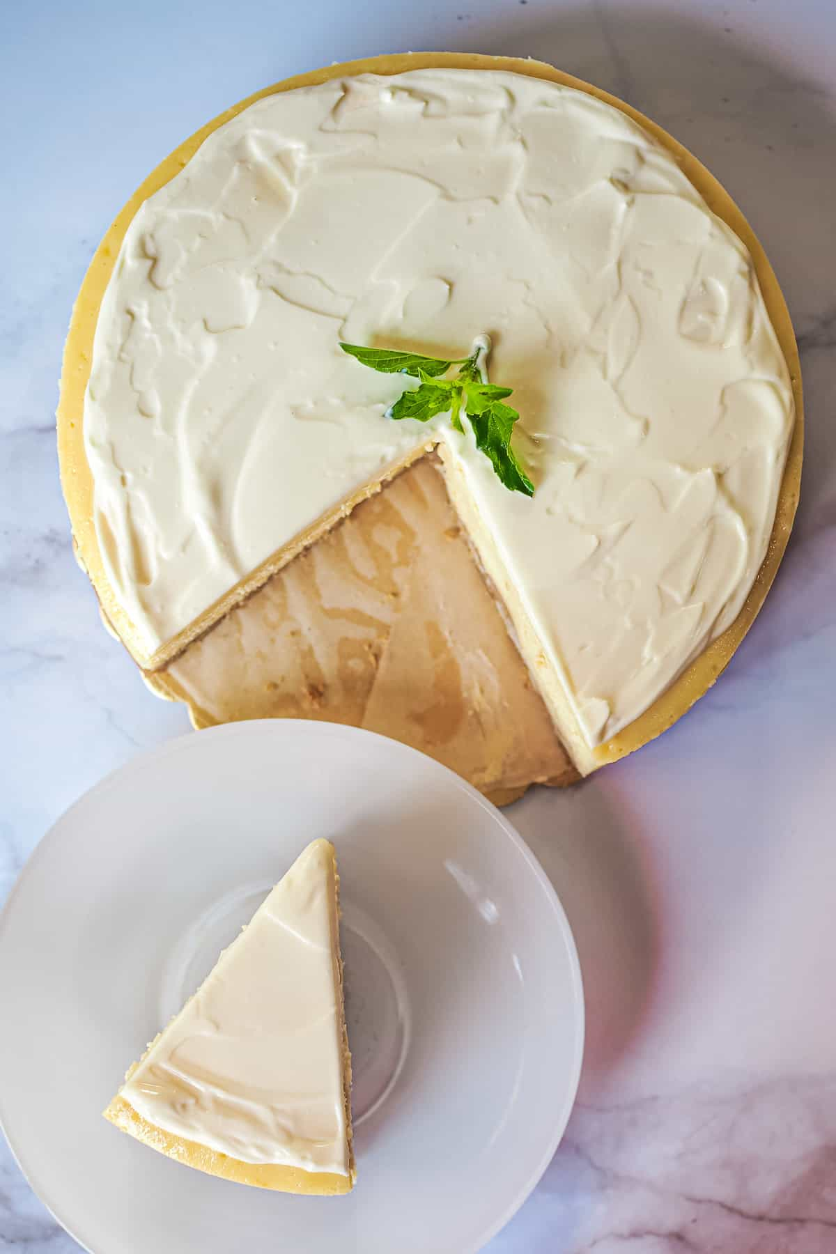 Top view of a round New York cheesecake, with a slice cut out