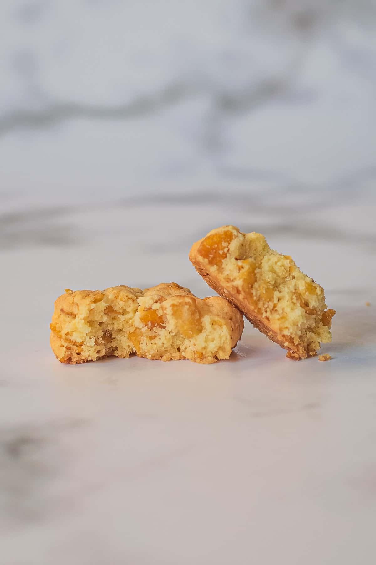 A cornflakes cookie broken into 2