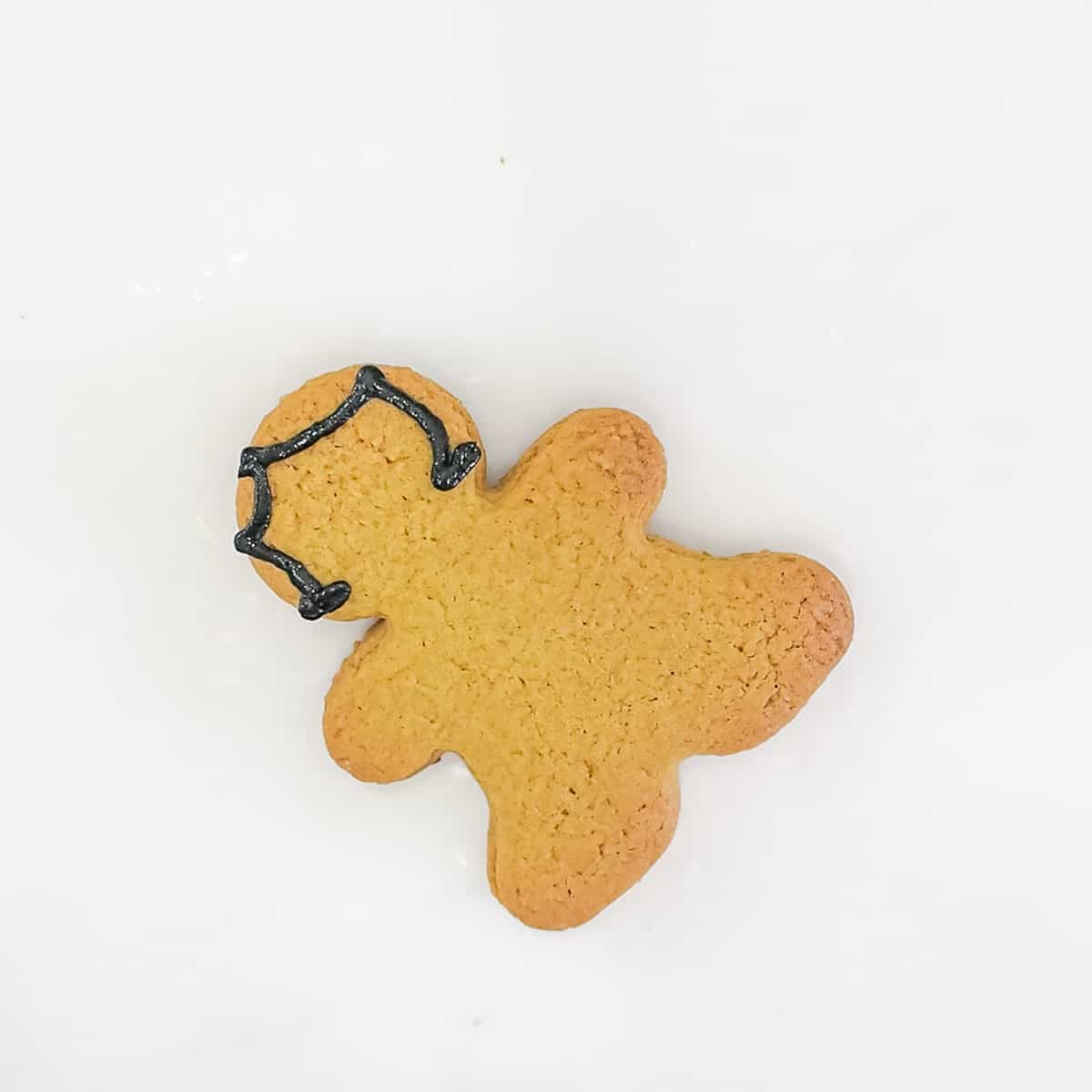 A gingerbread cookies with black icing outline for the hair.