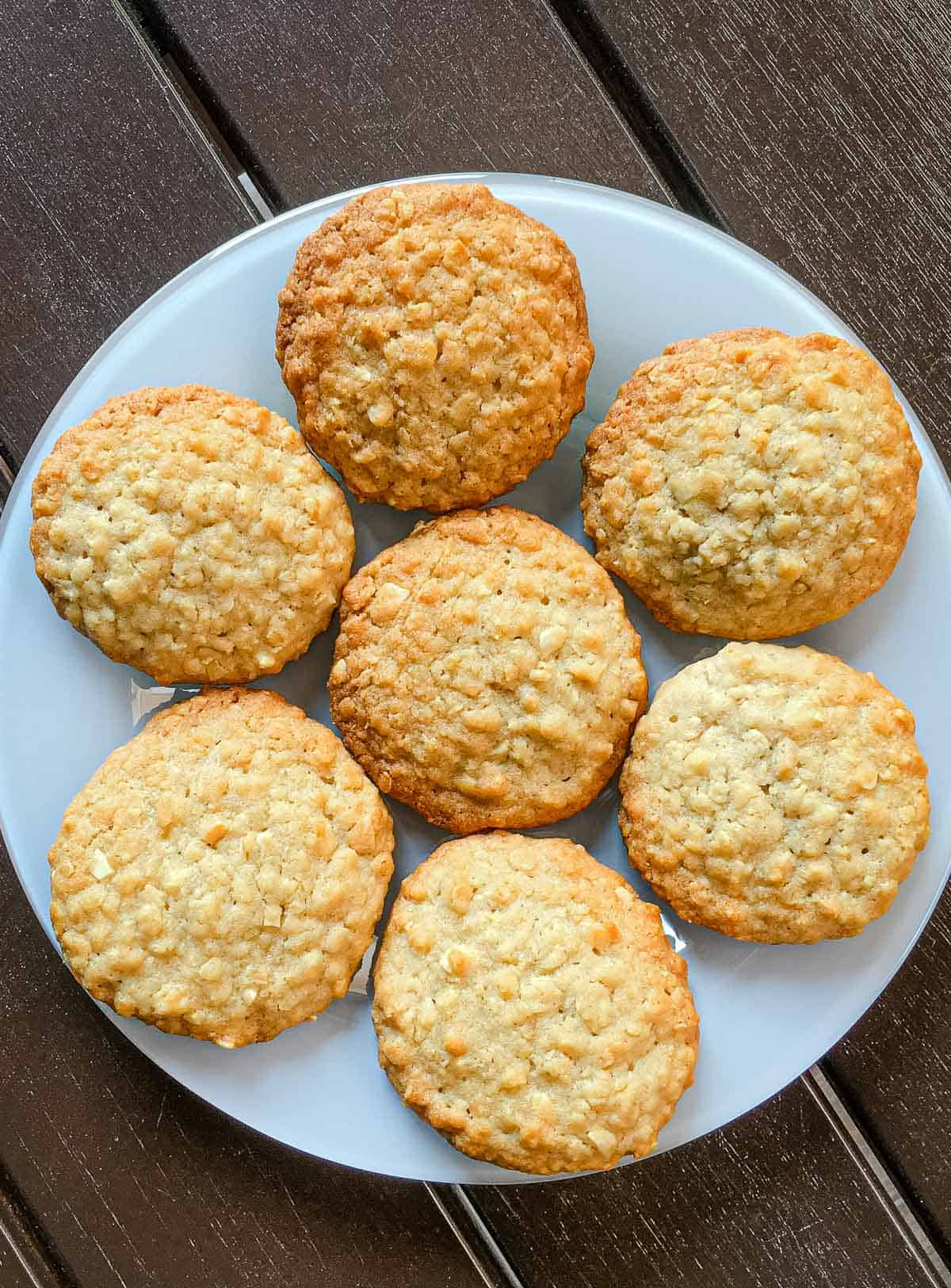 Almond oatmeal cookies arranged on a white plate