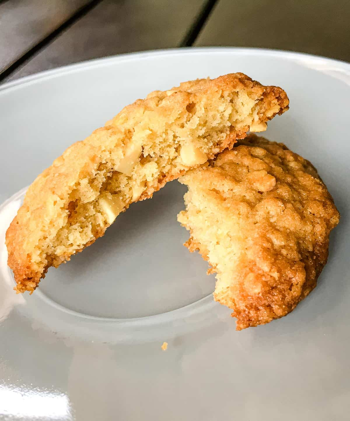 A round cookie broken into 2 on a white plate