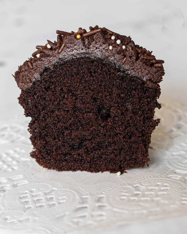 A chocolate cupcake cut into half