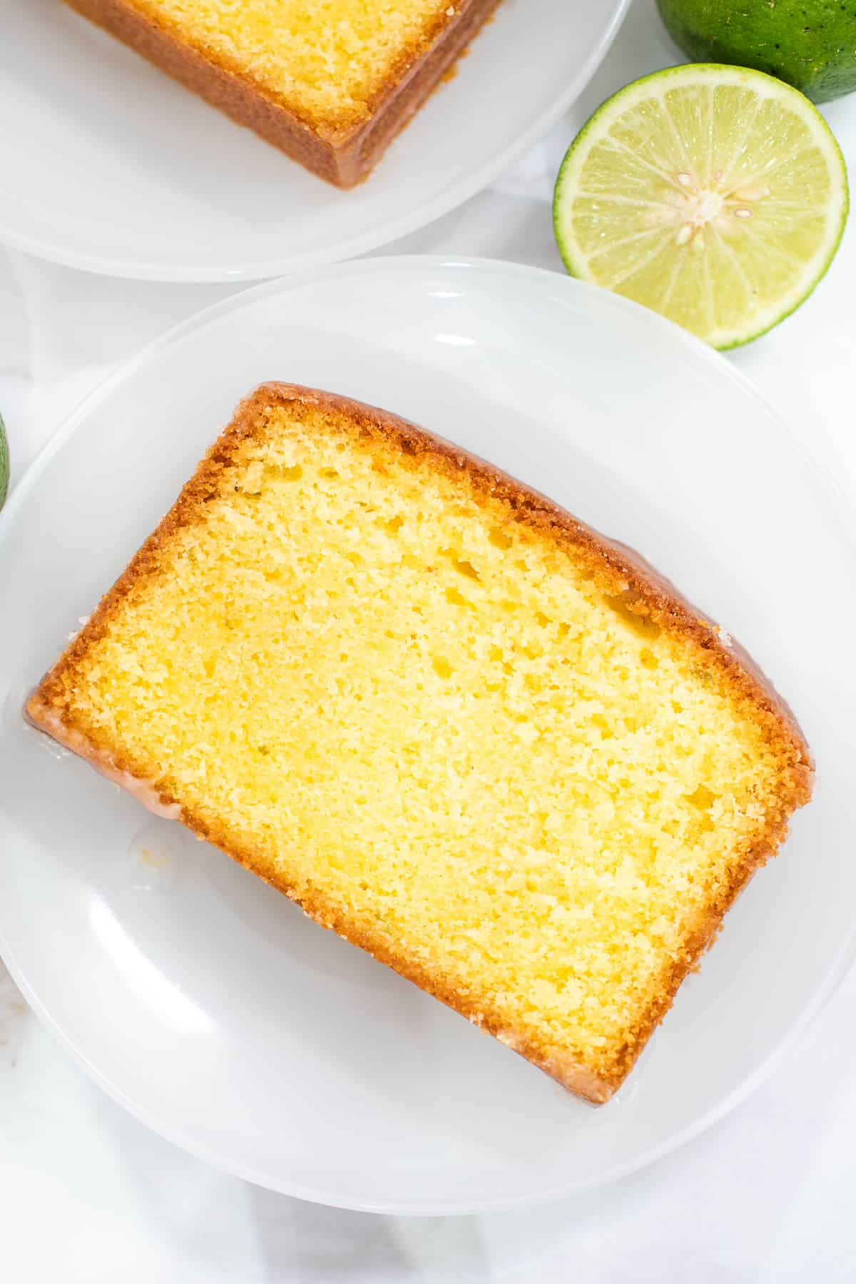 A slice of loaf cake on a white plate