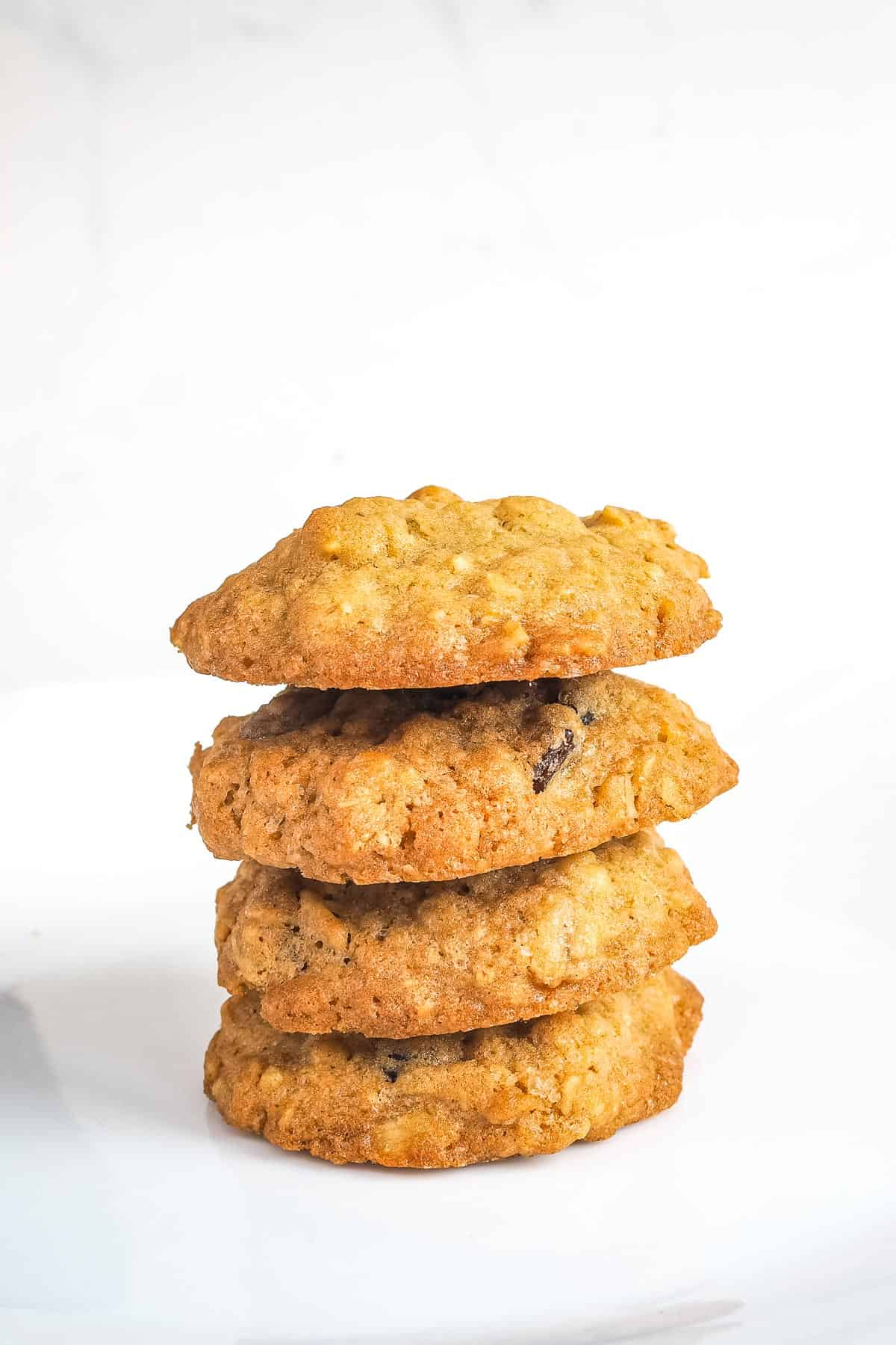 A stack of 4 old fashioned oatmeal raisin cookies