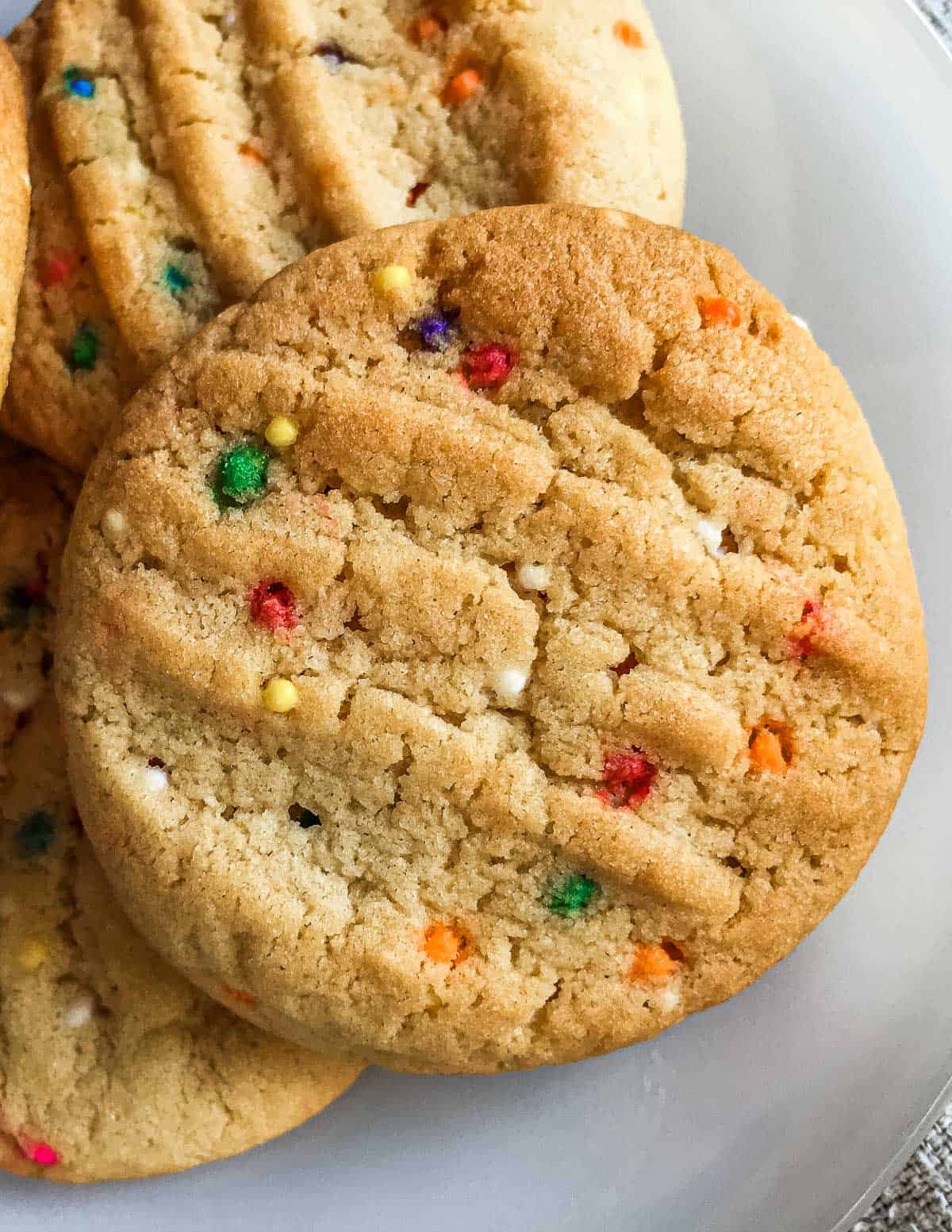 Round simple peanut butter cookies with sprinkles