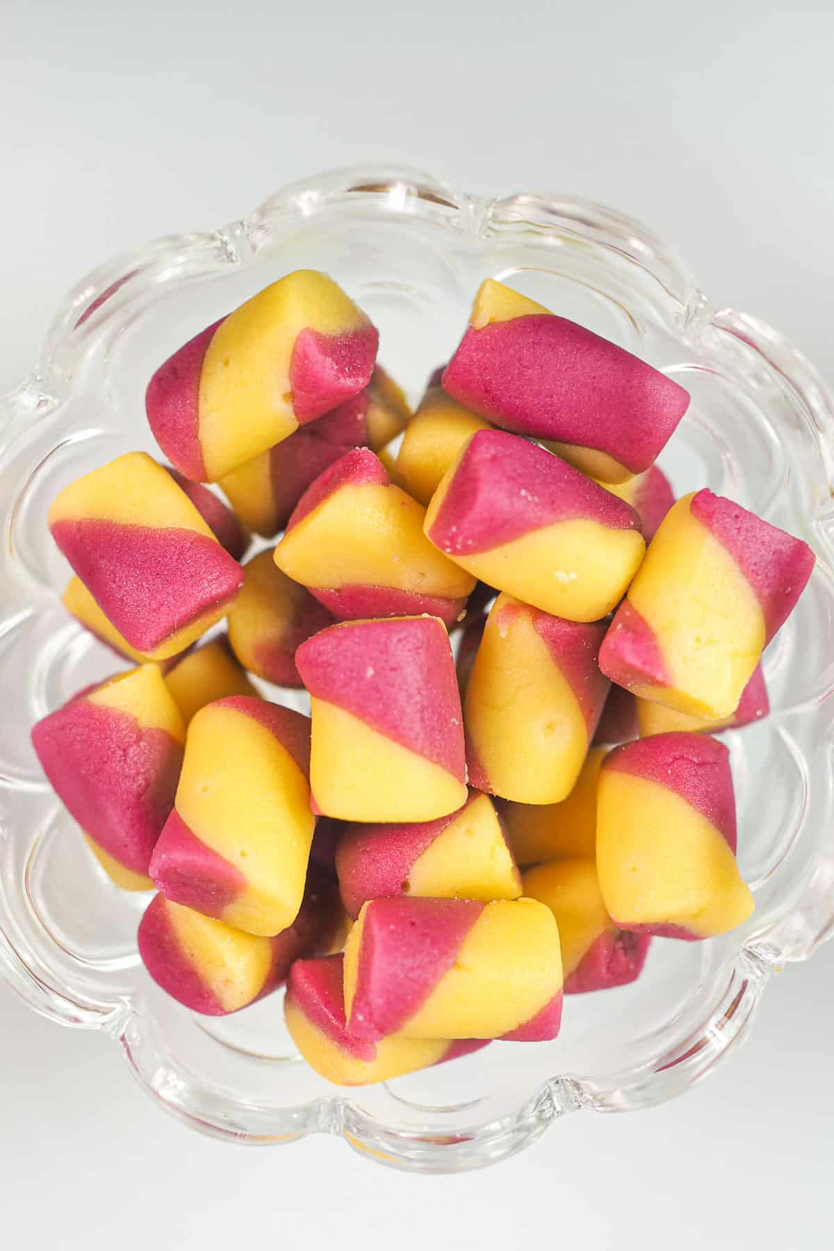 Pink and yellow butter mints candy in a glass jar