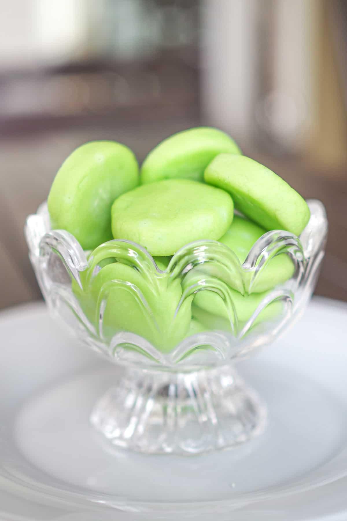 Green mint patties in a glass jar