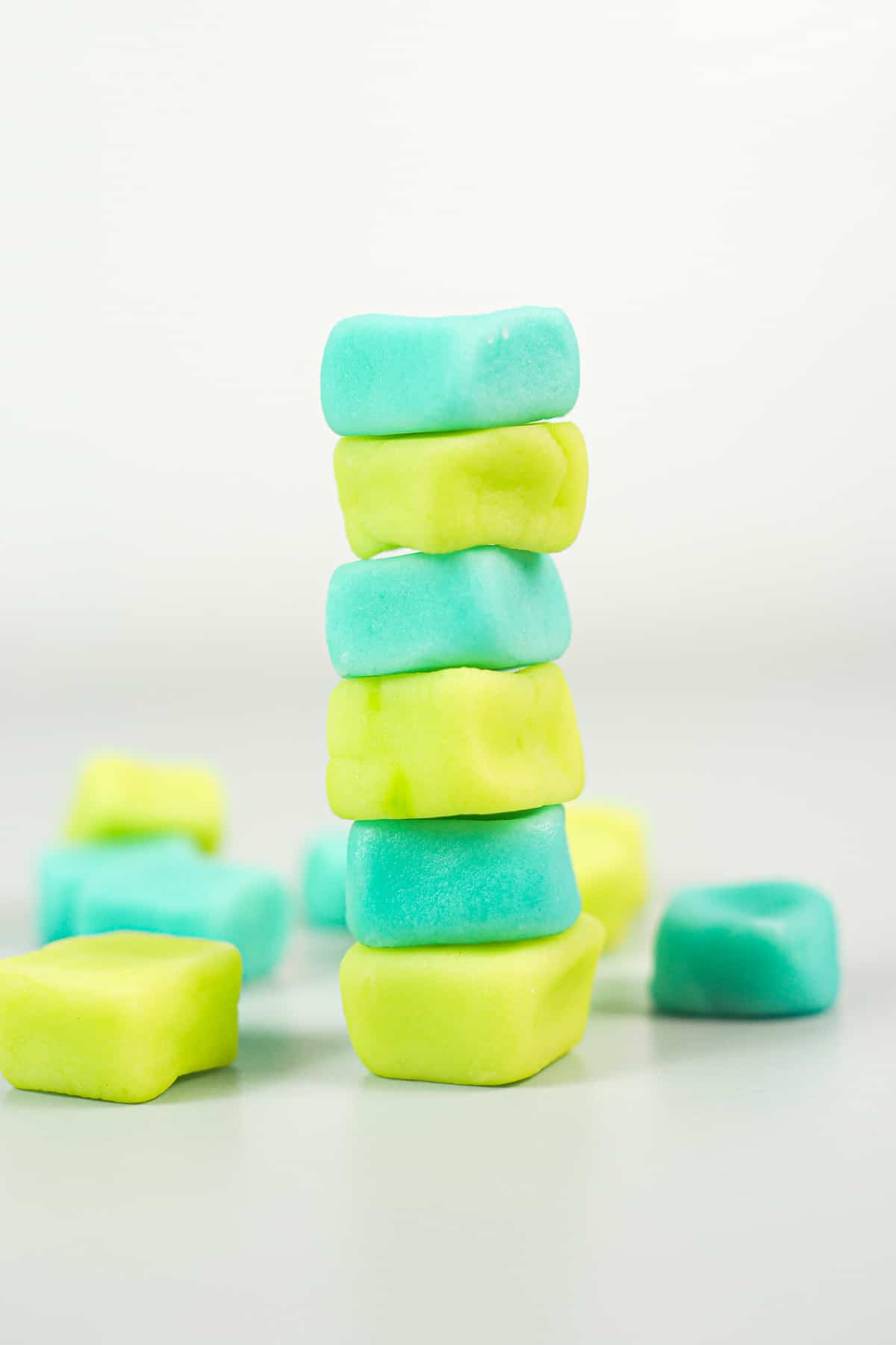 A stack of 6 blue and green cream cheese candy mints