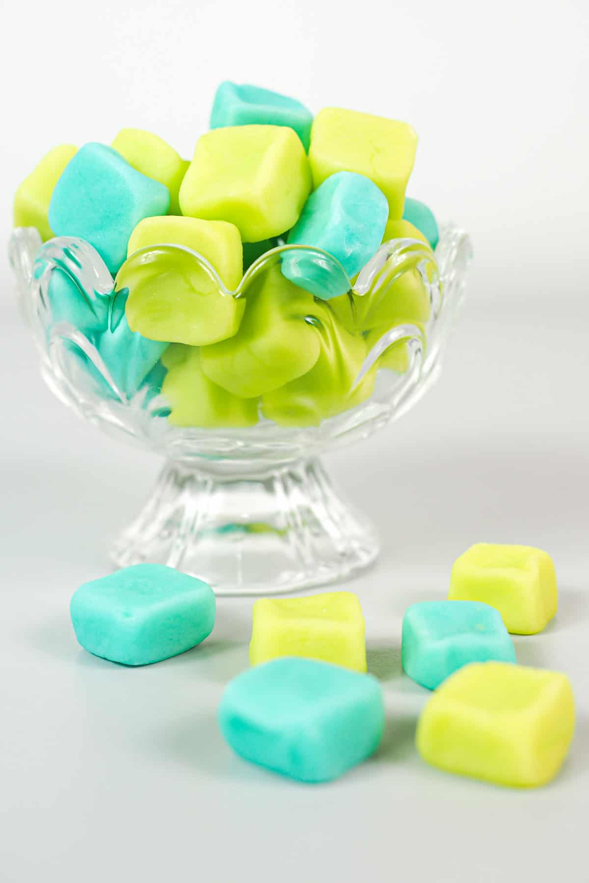 A glass jar of blue and green mints
