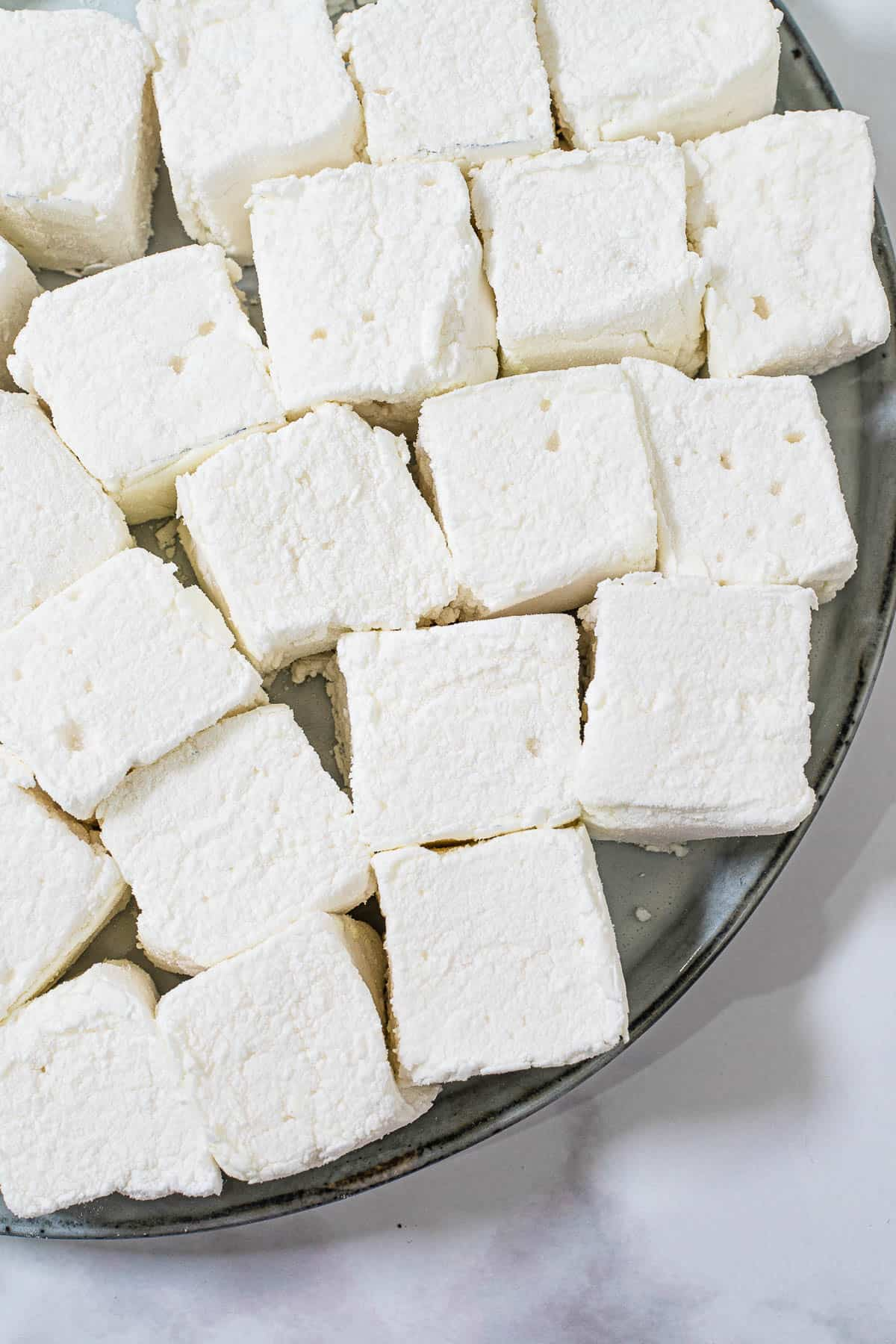A plate of square blocks of white marshmallows