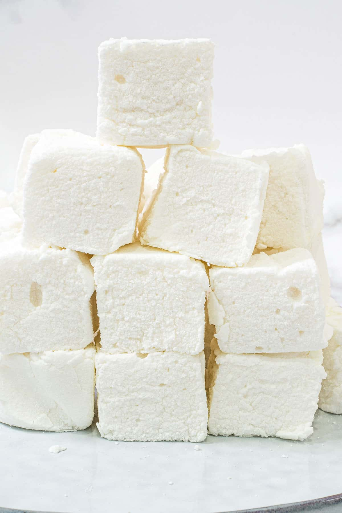 Close up of marshmallows stacked on a plate