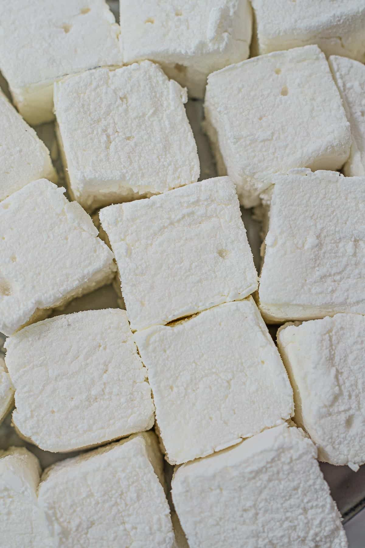 Close up of white square homemade marshmallows cut into squares