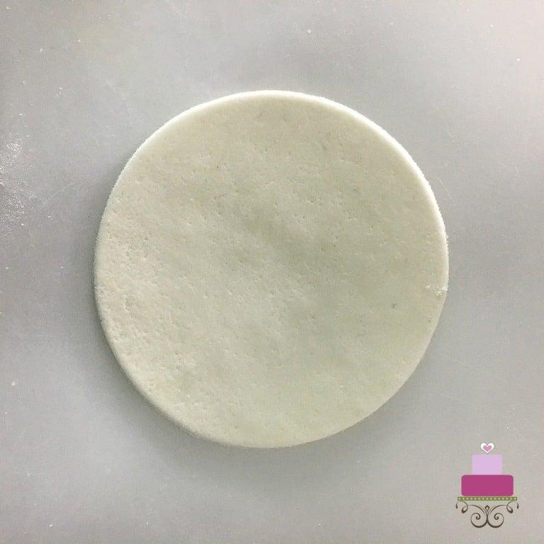 A round white fondant cut out
