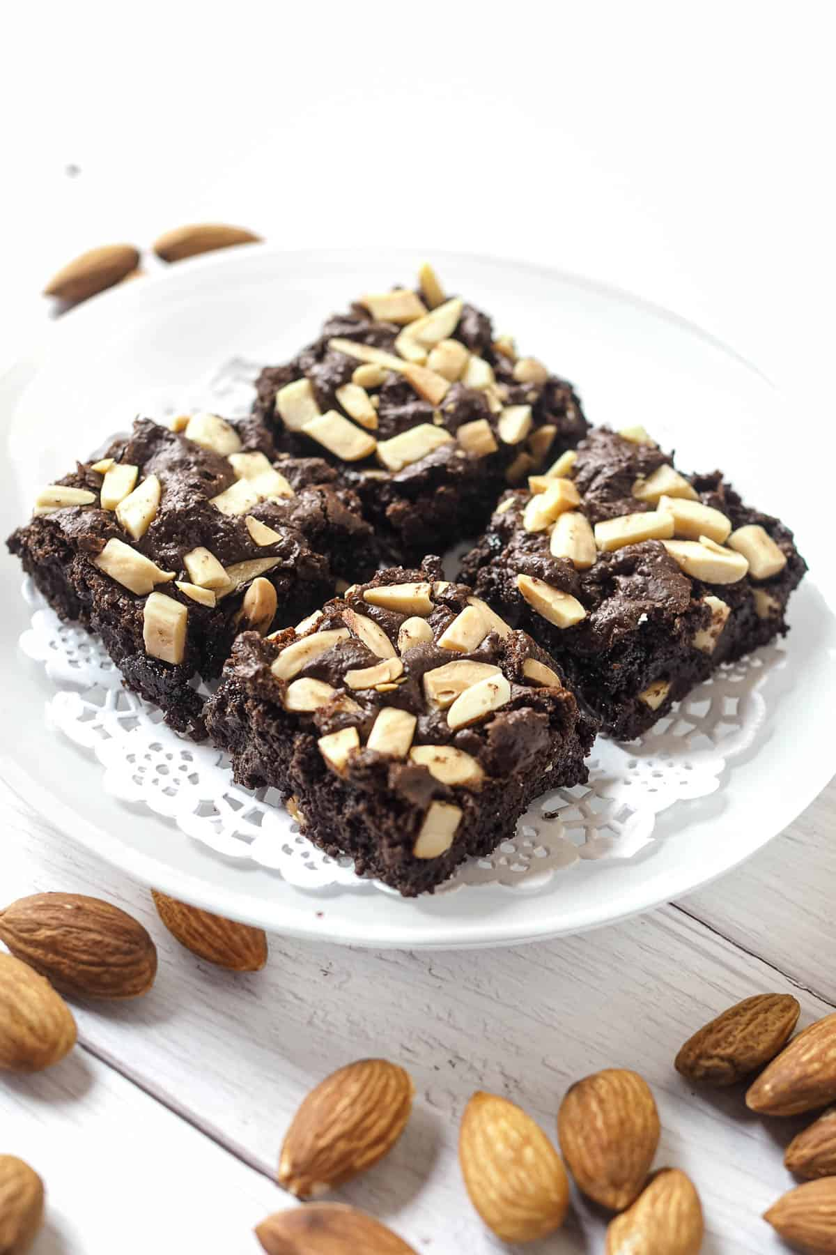 4 squares of brownies with almonds on top