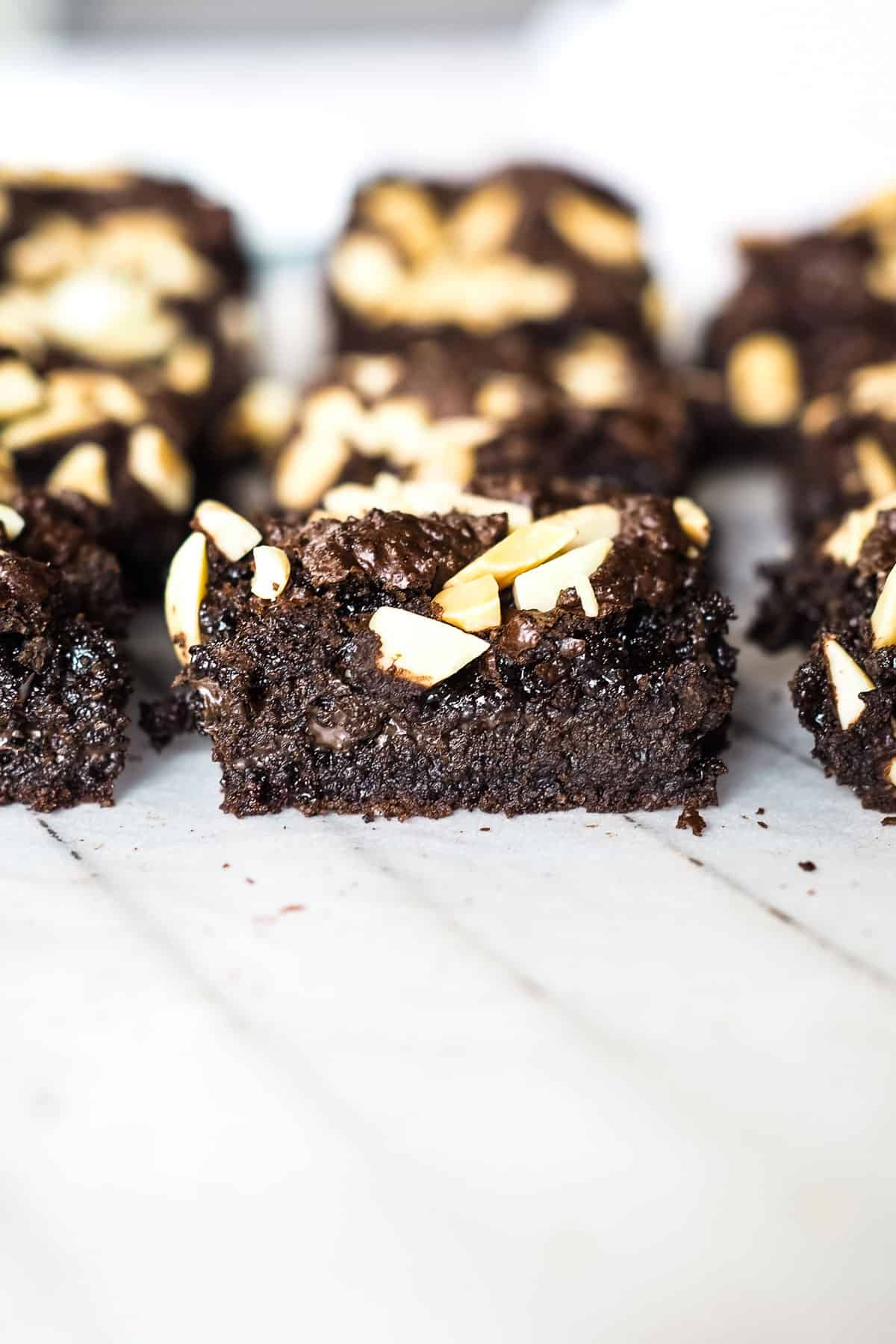 Almond brownies arranged on a row