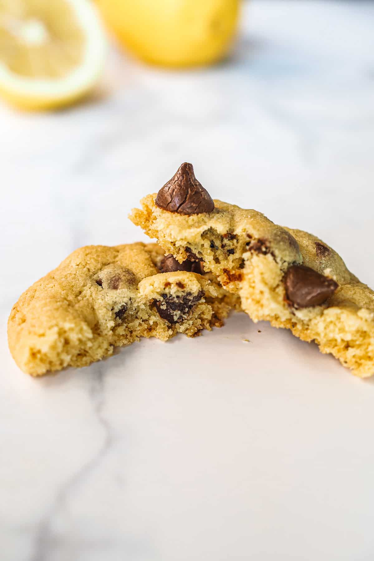 A chocolate chip cookie broken into 2