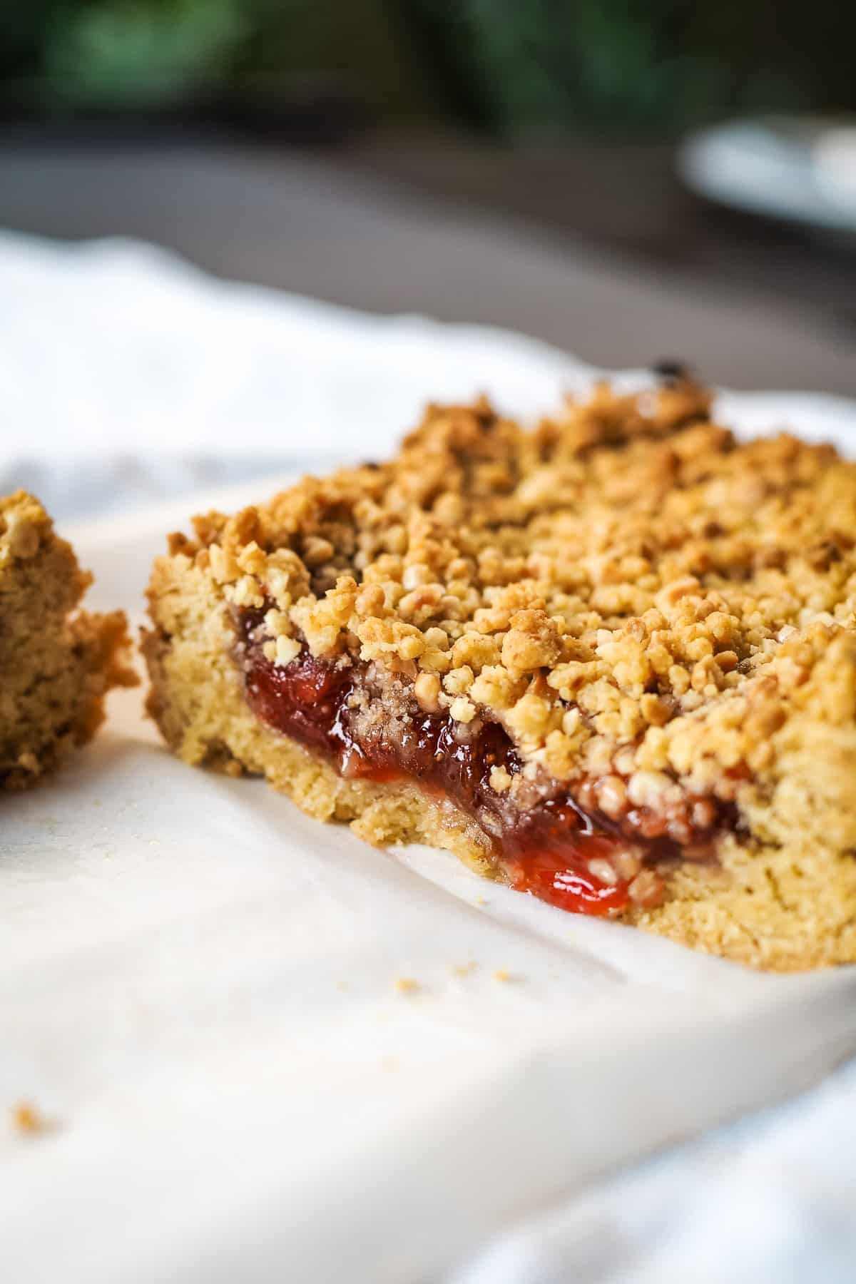 Sliced strawberry oat bar on a kitchen towel