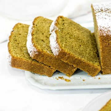 A loaf of green tea cake cut into slices