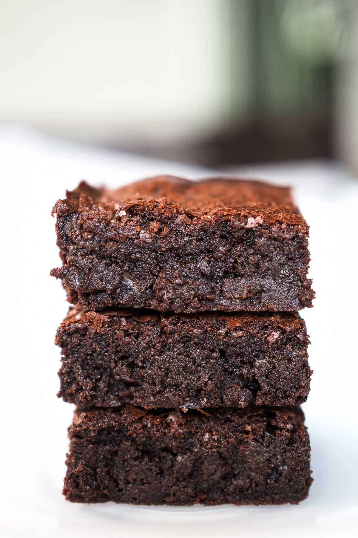 A stack of 3 square pieces of brownie