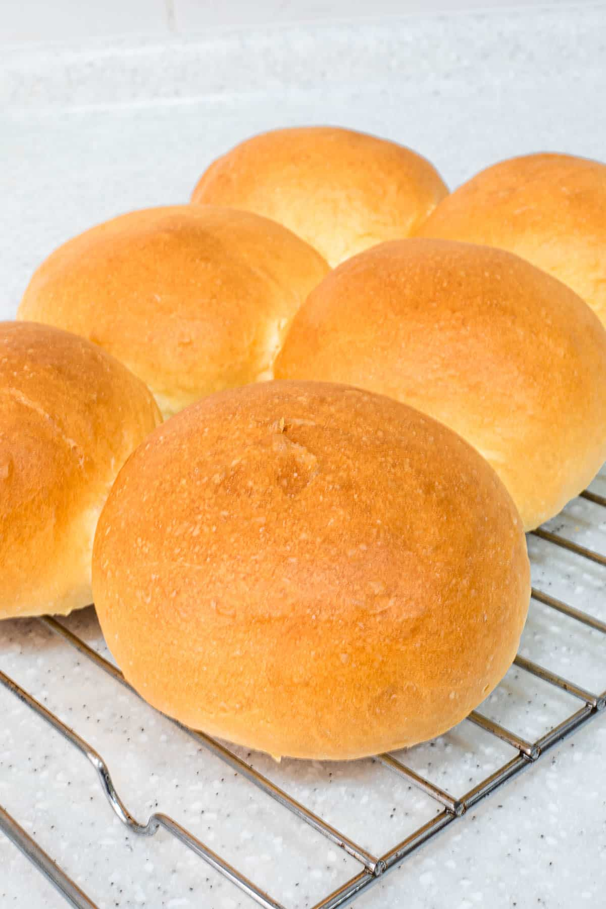 Baked buns on a wire rack