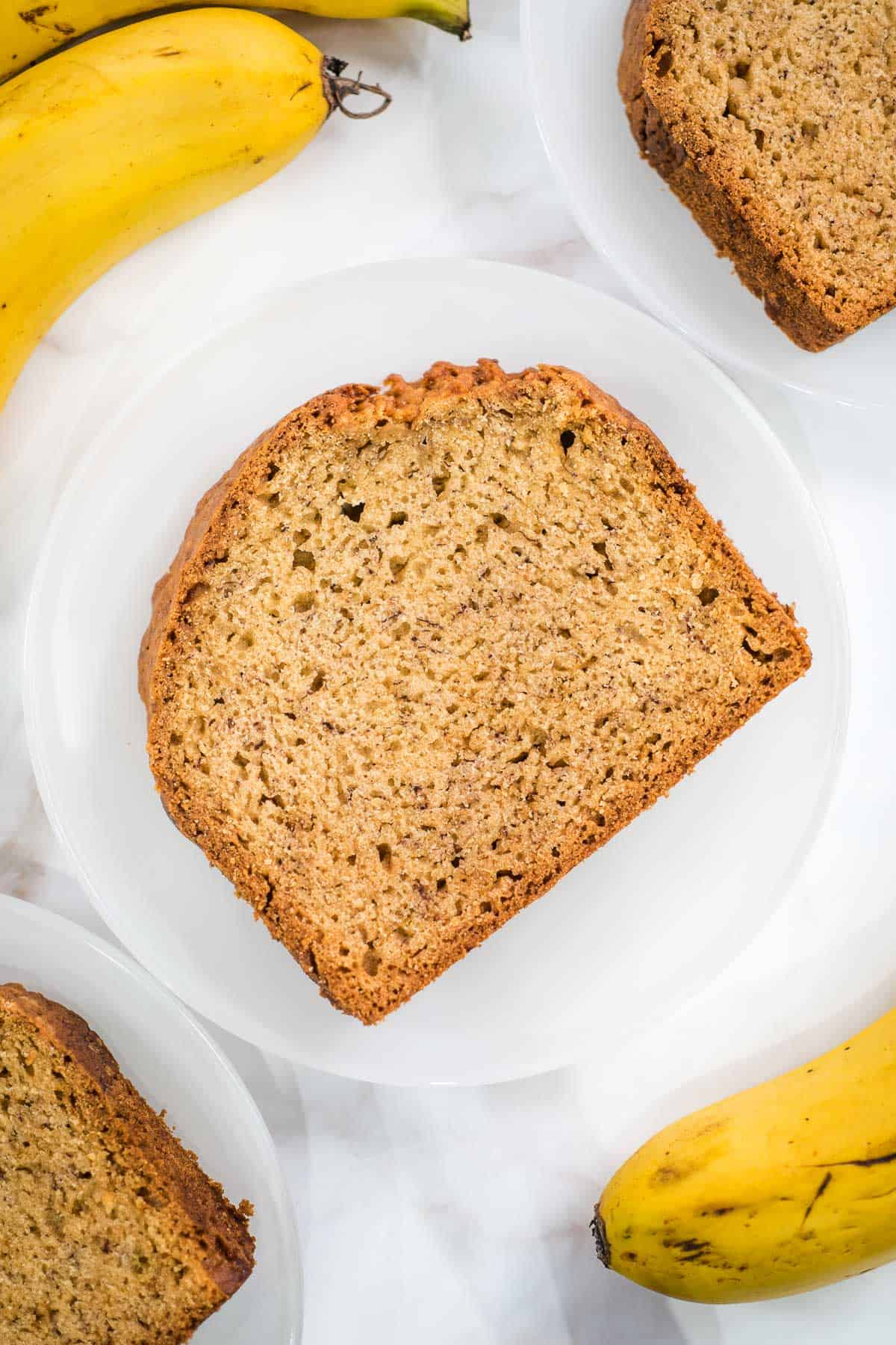 A slice of banana bread on a white plate